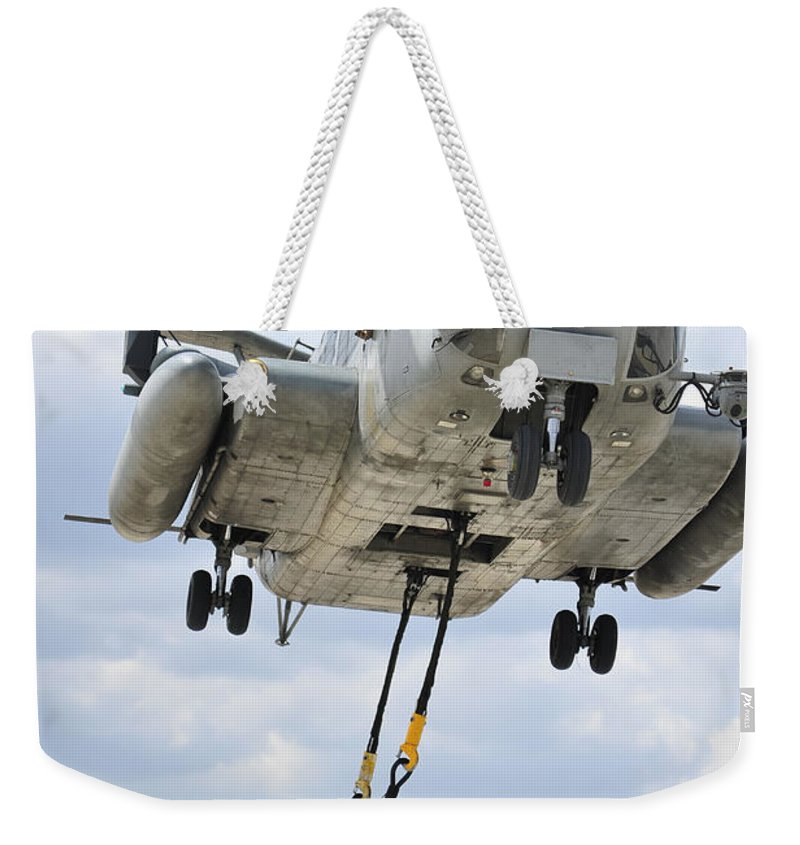 Military Weekender Tote Bag featuring the photograph U.s. Marines Conduct A Sling Load by Stocktrek Images
