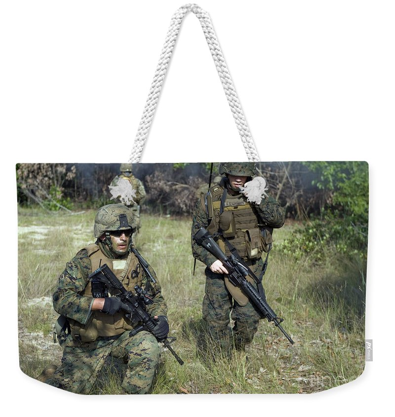 Exercise Carat Weekender Tote Bag featuring the photograph U.s. Marines Secure A Perimeter by Stocktrek Images