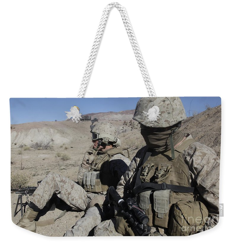 Us Marine Corps Weekender Tote Bag featuring the photograph U.s. Marines Take A Break by Stocktrek Images