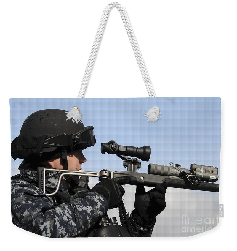 Military Weekender Tote Bag featuring the photograph U.s. Navy Chief Uses An La9p Nonlethal by Stocktrek Images