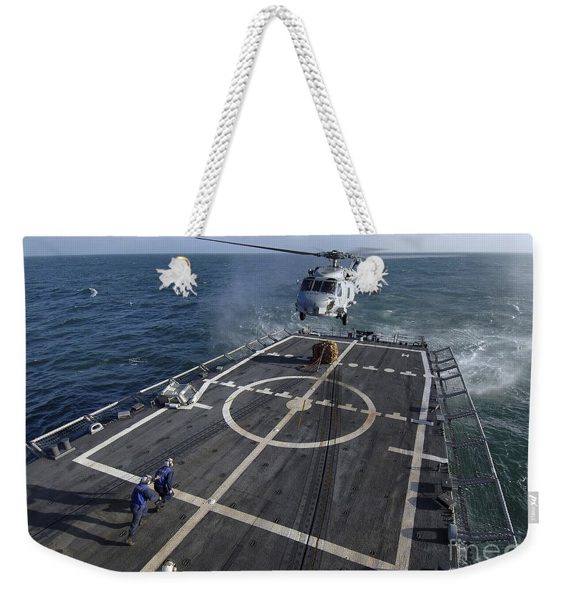 Guided Missile Frigate Weekender Tote Bag featuring the photograph U.s. Navy Sailors Prepare To Attach by Stocktrek Images