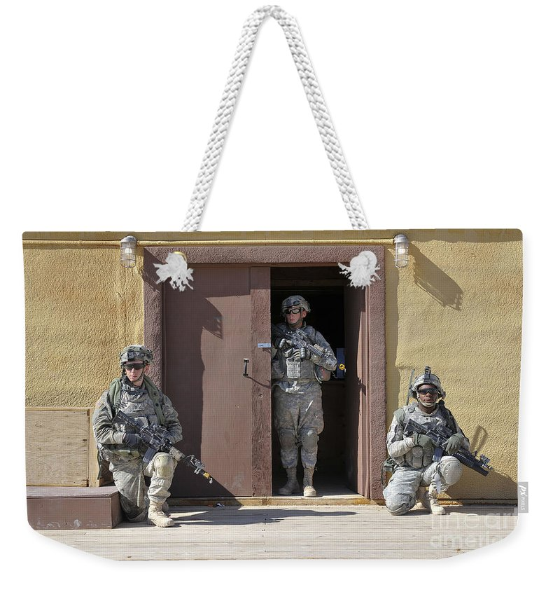 Vigilant Weekender Tote Bag featuring the photograph U.s. Soldiers On Guard At Fort Irwin by Stocktrek Images