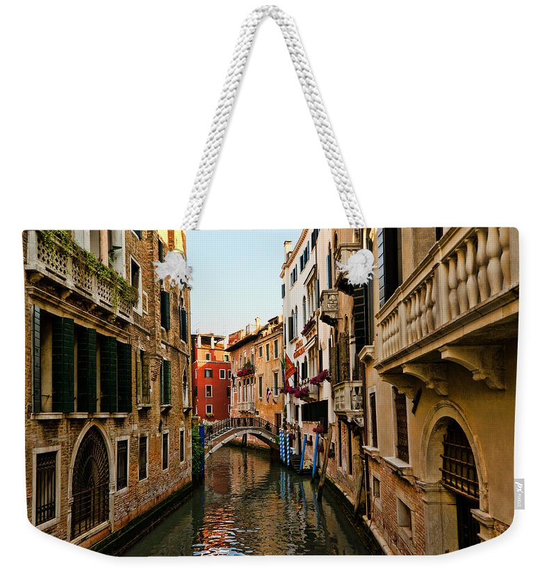 Venice Weekender Tote Bag featuring the photograph Venice Waterway by Jon Berghoff