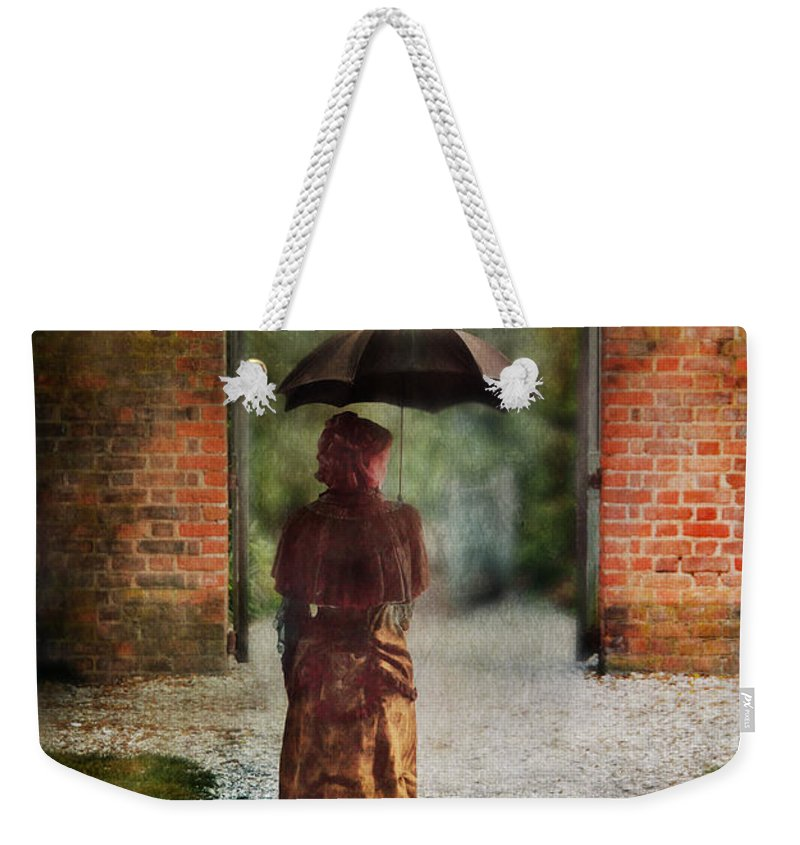 Lady Weekender Tote Bag featuring the photograph Victorian Lady By Brick Archway by Jill Battaglia