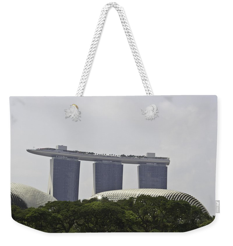 Asia Weekender Tote Bag featuring the photograph View Of Marina Bay Sands And Esplanade Building In Singapore by Ashish Agarwal
