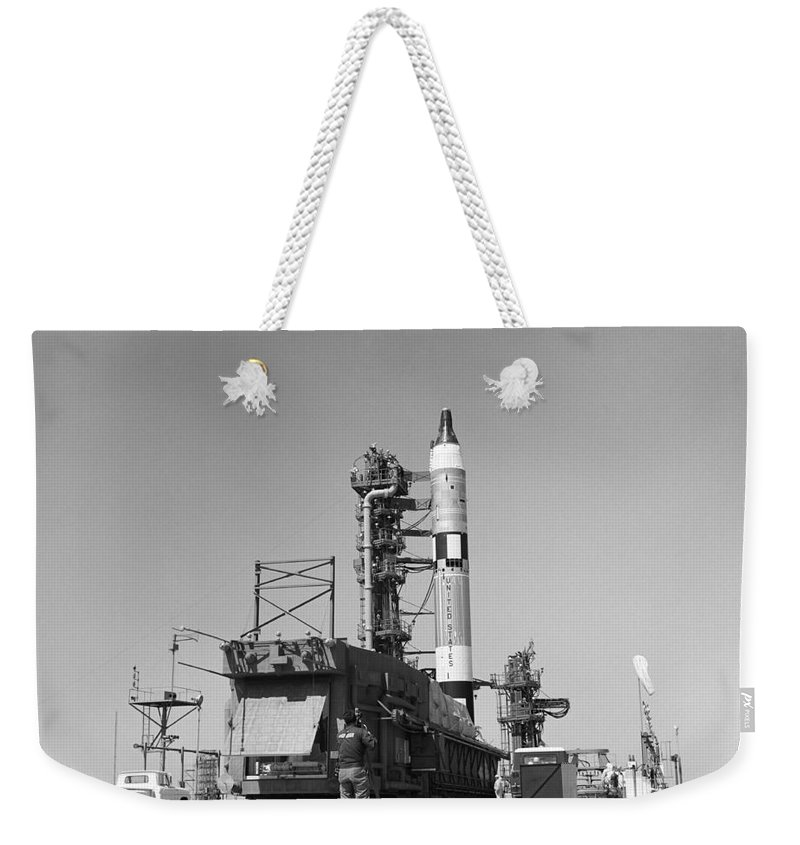 1965 Weekender Tote Bag featuring the photograph View Of The Gemini-titan 3 by Stocktrek Images