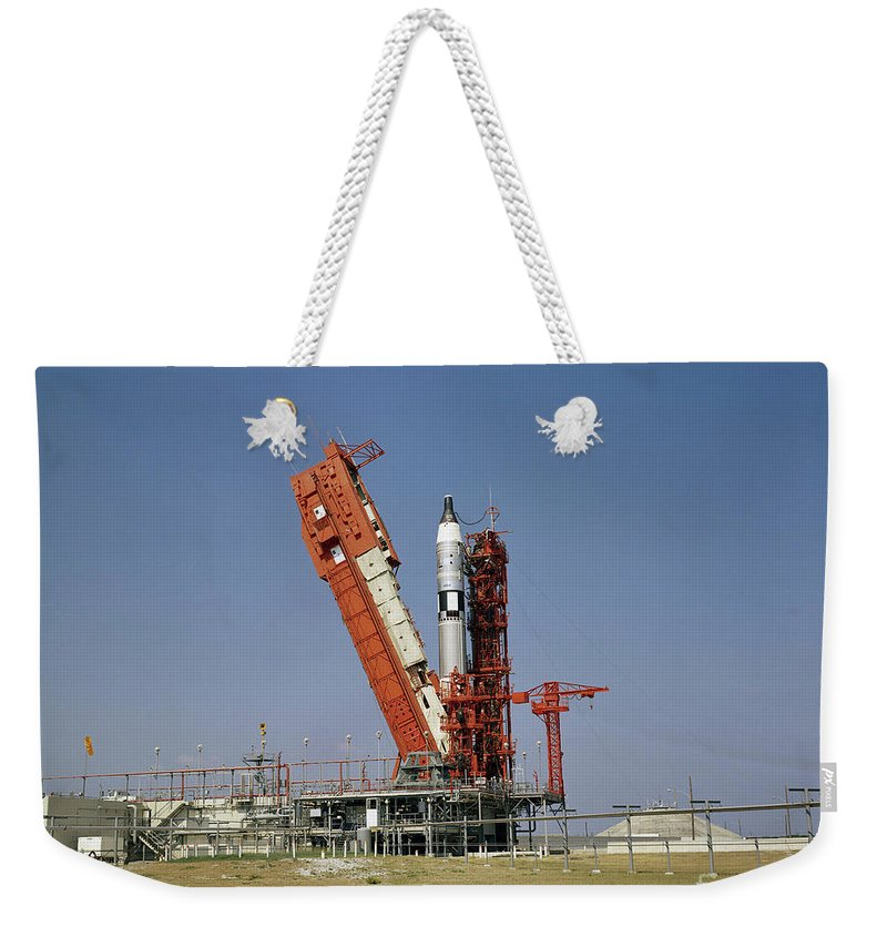 1965 Weekender Tote Bag featuring the photograph View Of The Gemini-titan 4 Spacecraft by Stocktrek Images