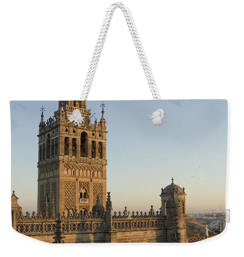 Spain Weekender Tote Bag featuring the photograph View Of The Giralda Tower by Krista Rossow