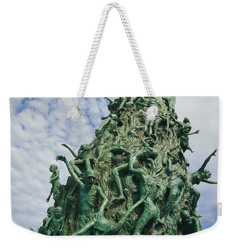 North America Weekender Tote Bag featuring the photograph View Of The Holocaust Memorial by Richard Nowitz
