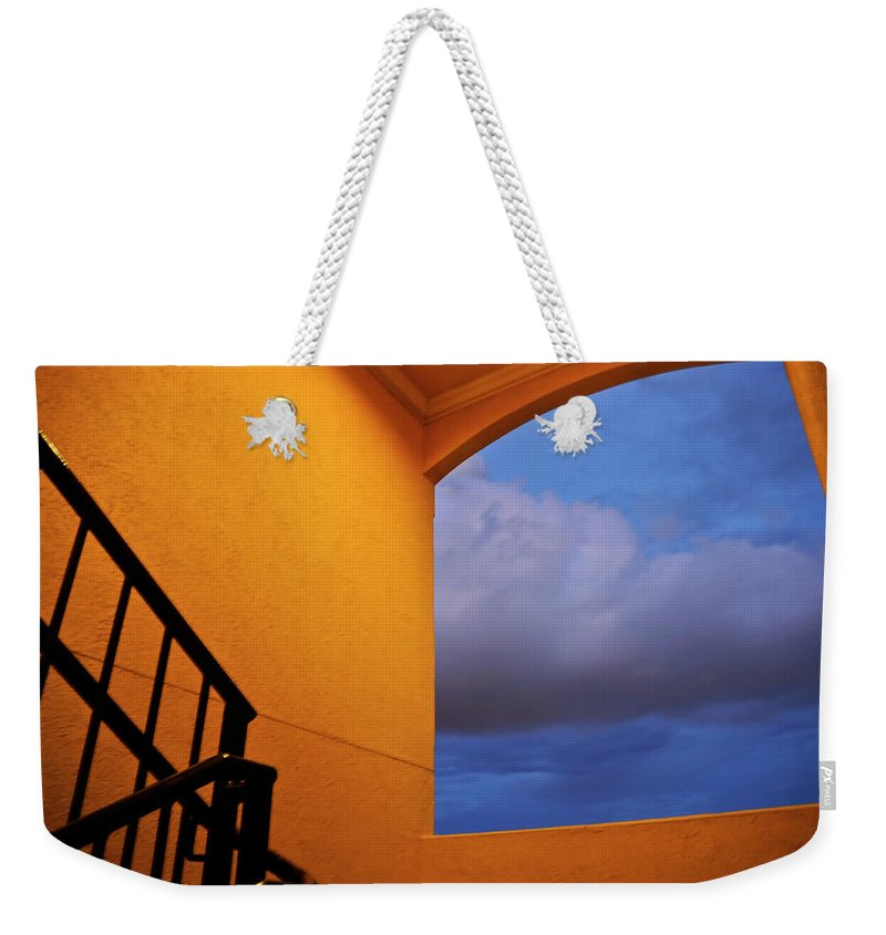 Window Weekender Tote Bag featuring the photograph View Through A Stairwell by Carolyn Marshall
