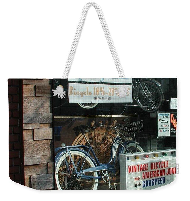 Vintage Bicycle And American Junk Godspeed Weekender Tote Bag featuring the photograph Vintage Bicycle And American Junk by Anna Ruzsan