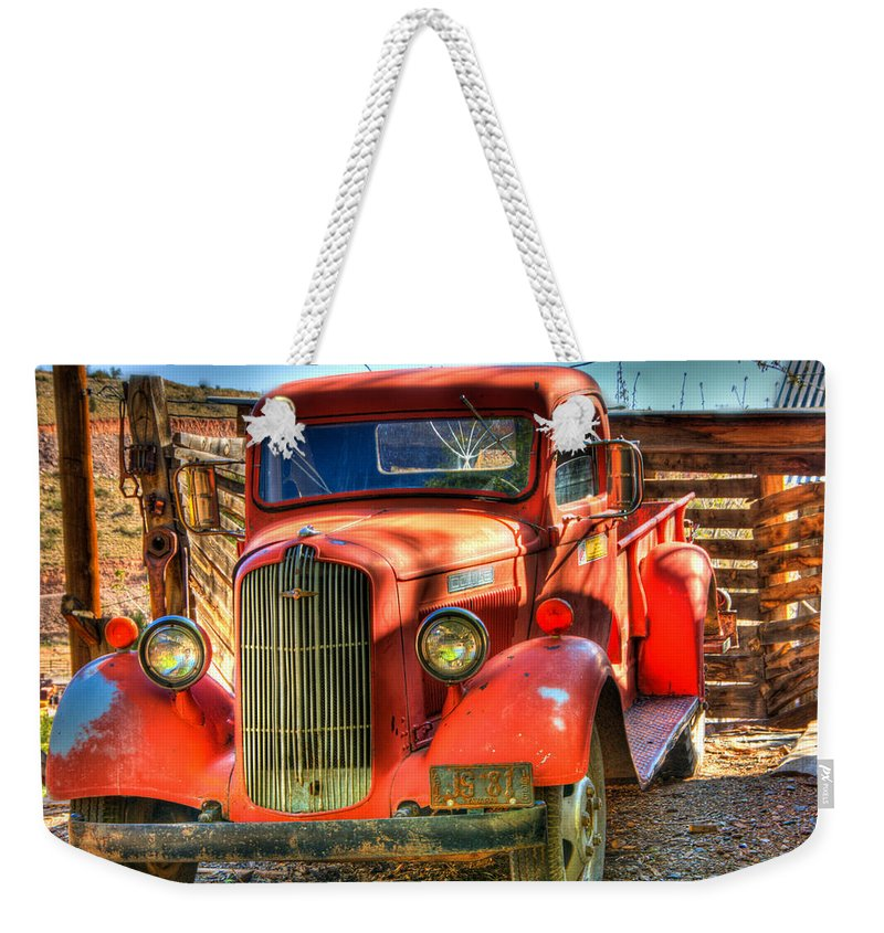 Truck Weekender Tote Bag featuring the photograph Vintage Red Dodge by Jon Berghoff