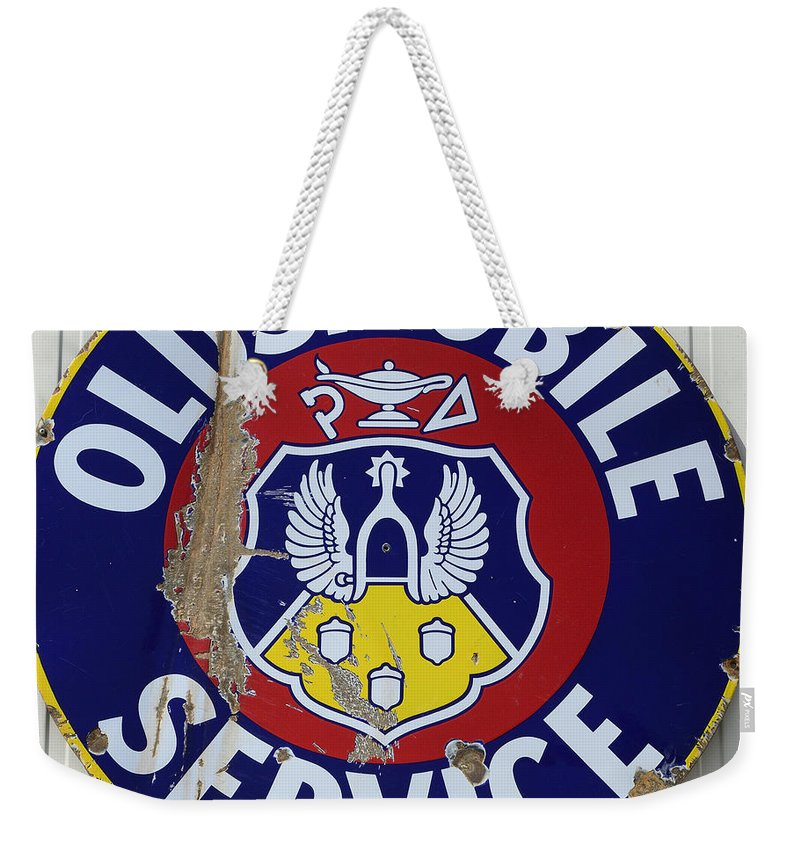 Vintage Signs Weekender Tote Bag featuring the photograph Vintage Sign Oldsmobile Service by Bob Christopher
