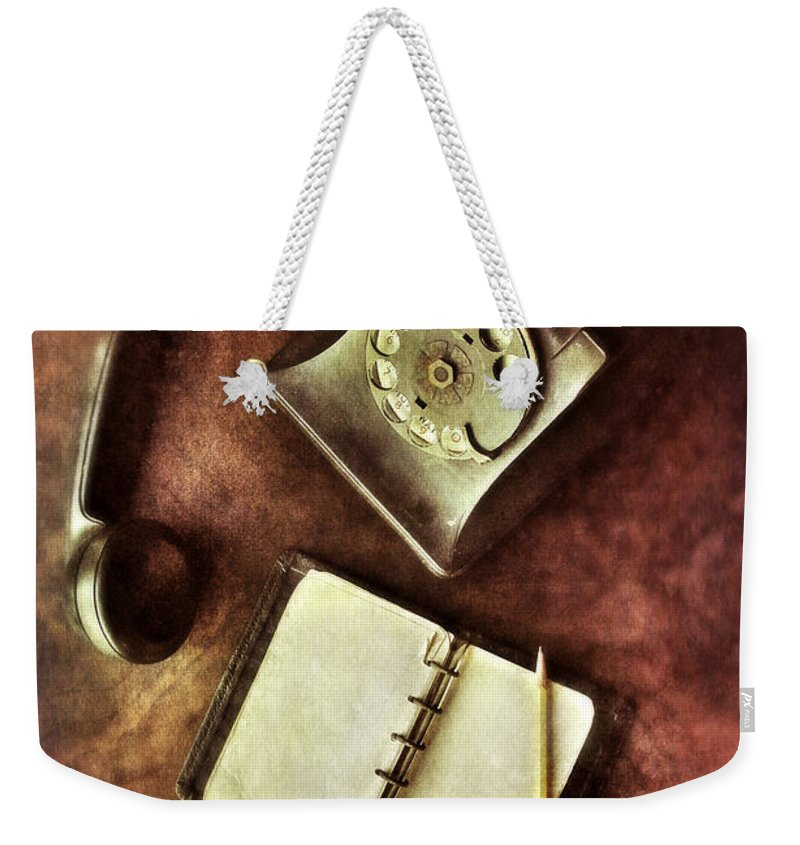 Telephone Weekender Tote Bag featuring the photograph Vintage Telephone And Notebook. by Jill Battaglia