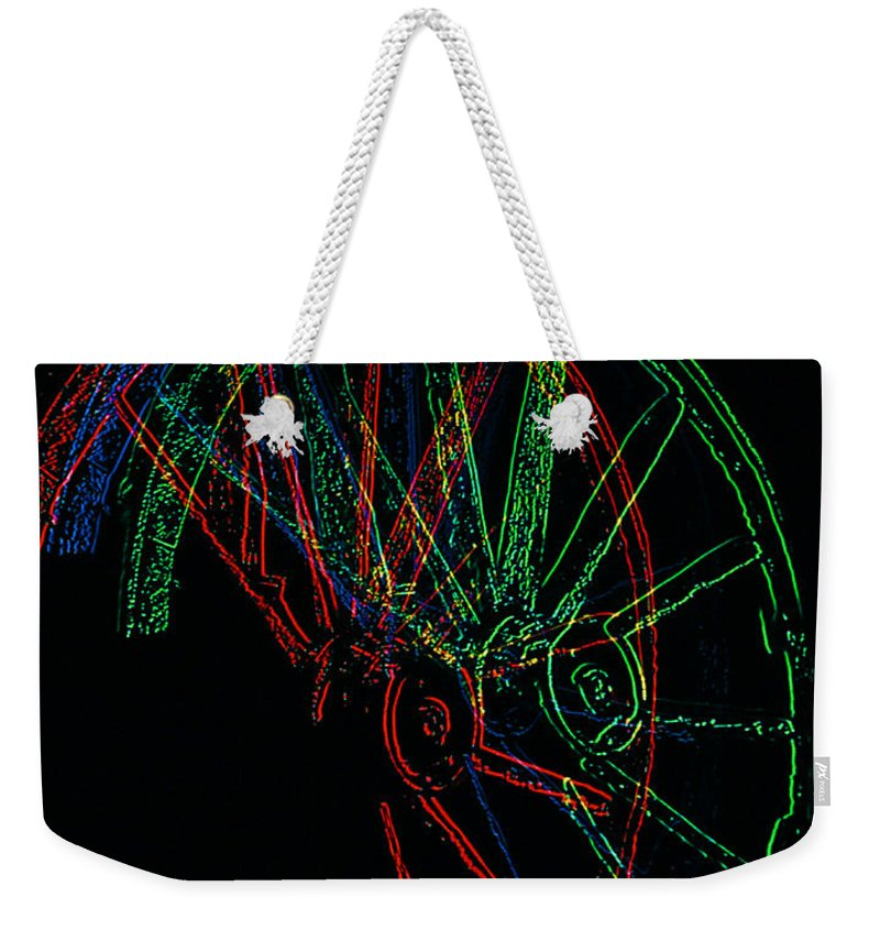 Wagon Wheels Weekender Tote Bag featuring the photograph Wagon Wheels In Wheels by Rich Walter
