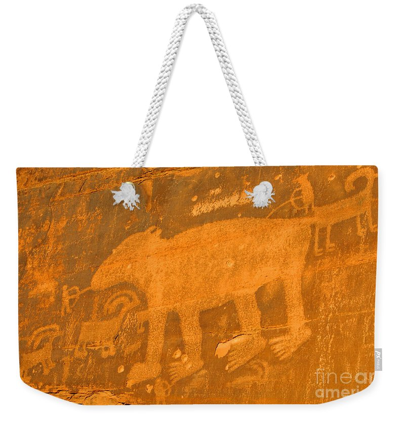Petroglyph Weekender Tote Bag featuring the photograph Wall Street Cliffs Petroglyph - Moab by Gary Whitton