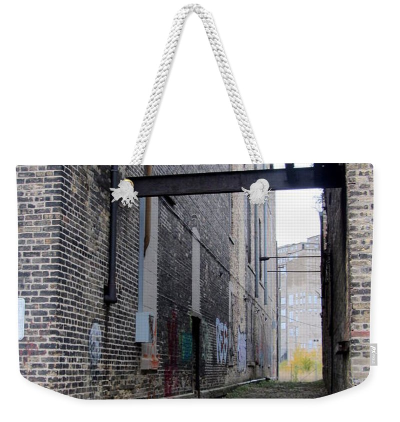 Milwaukee Weekender Tote Bag featuring the photograph Warehouse Beams And Grafitti by Anita Burgermeister