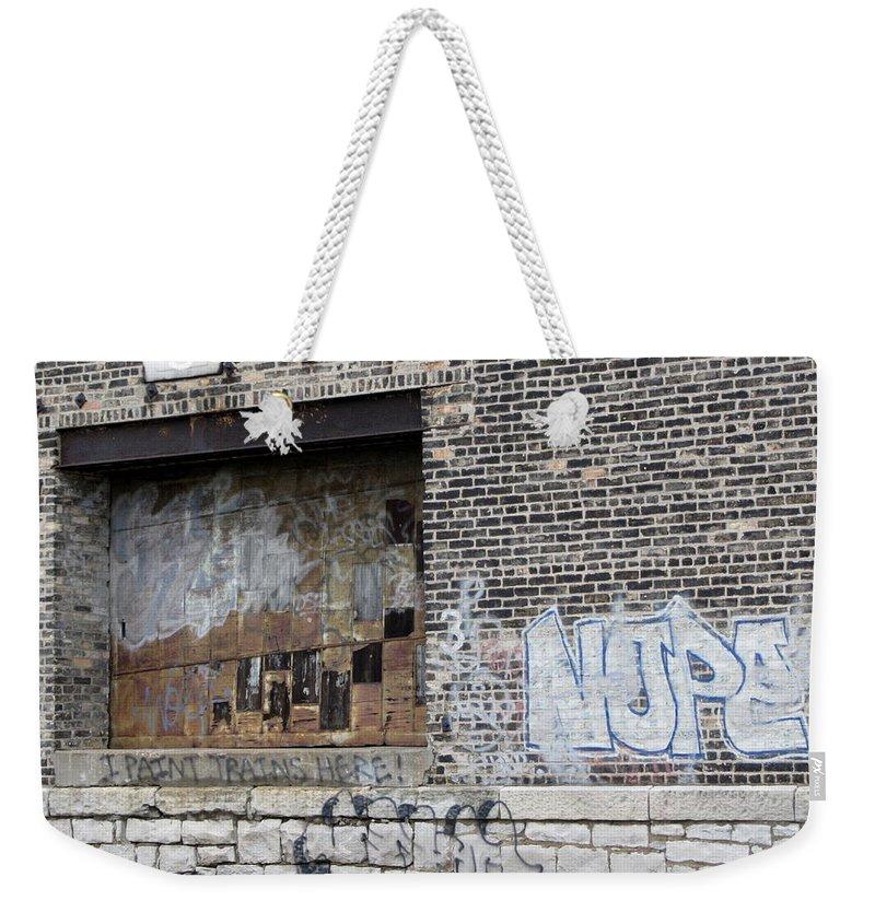 Milwaukee Weekender Tote Bag featuring the photograph Warehouse Grafitti 2 by Anita Burgermeister