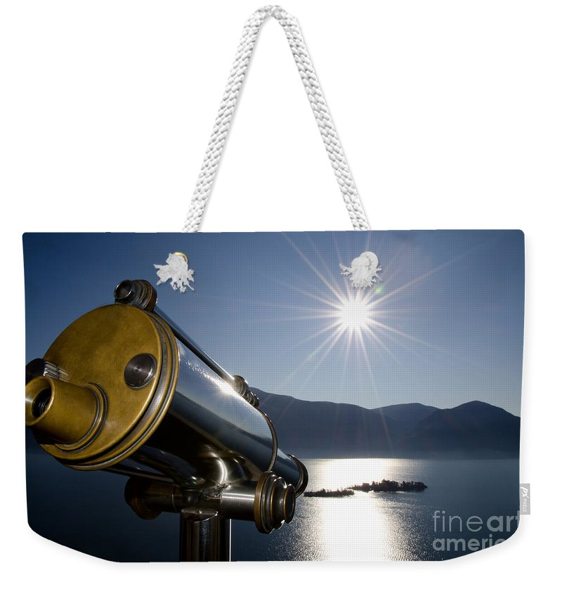 Telescope Weekender Tote Bag featuring the photograph Watching With A Telescope Islands by Mats Silvan
