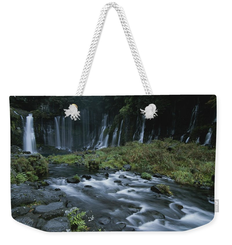 Asia Weekender Tote Bag featuring the photograph Water Falling And Flowing Over Rocks by Karen Kasmauski