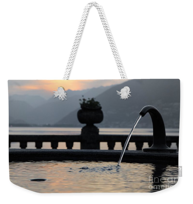Fountain Weekender Tote Bag featuring the photograph Water Fountain by Mats Silvan