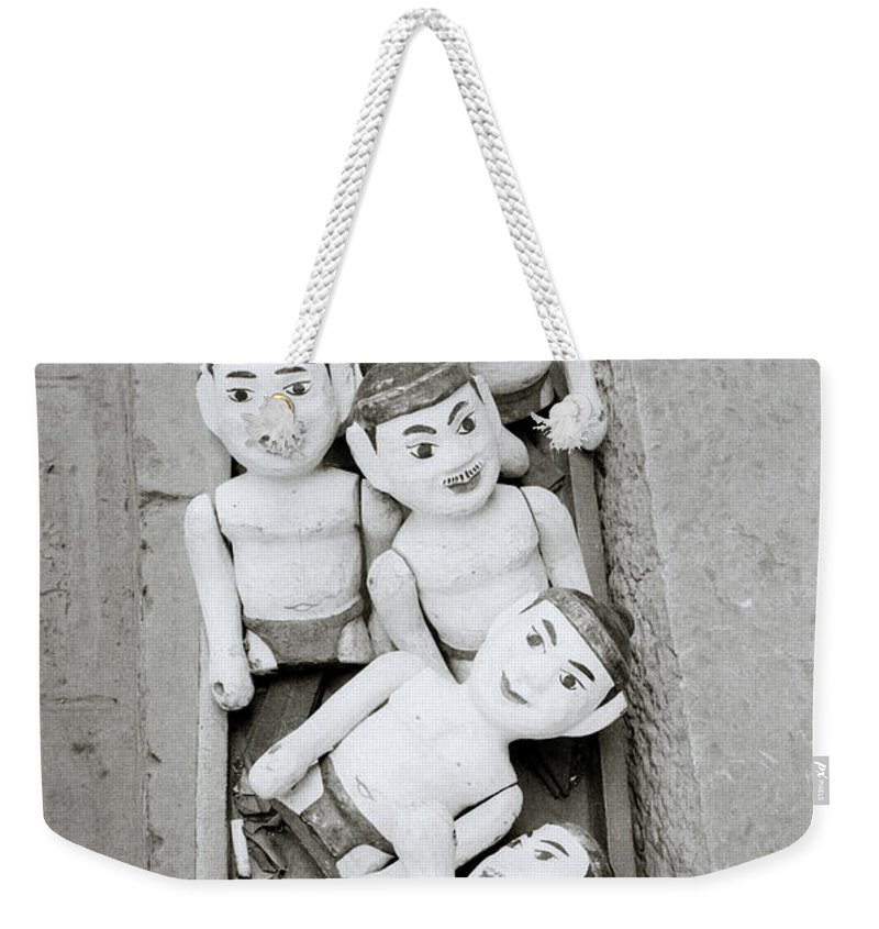 Asia Weekender Tote Bag featuring the photograph Water Puppets In Hanoi by Shaun Higson