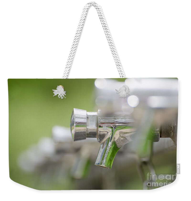 Water Tap Weekender Tote Bag featuring the photograph Water Taps by Mats Silvan
