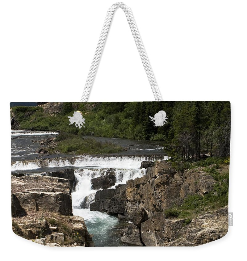 Swiftcurrent Lake Weekender Tote Bag featuring the photograph Waterfall At Many Glacier by Lorraine Devon Wilke