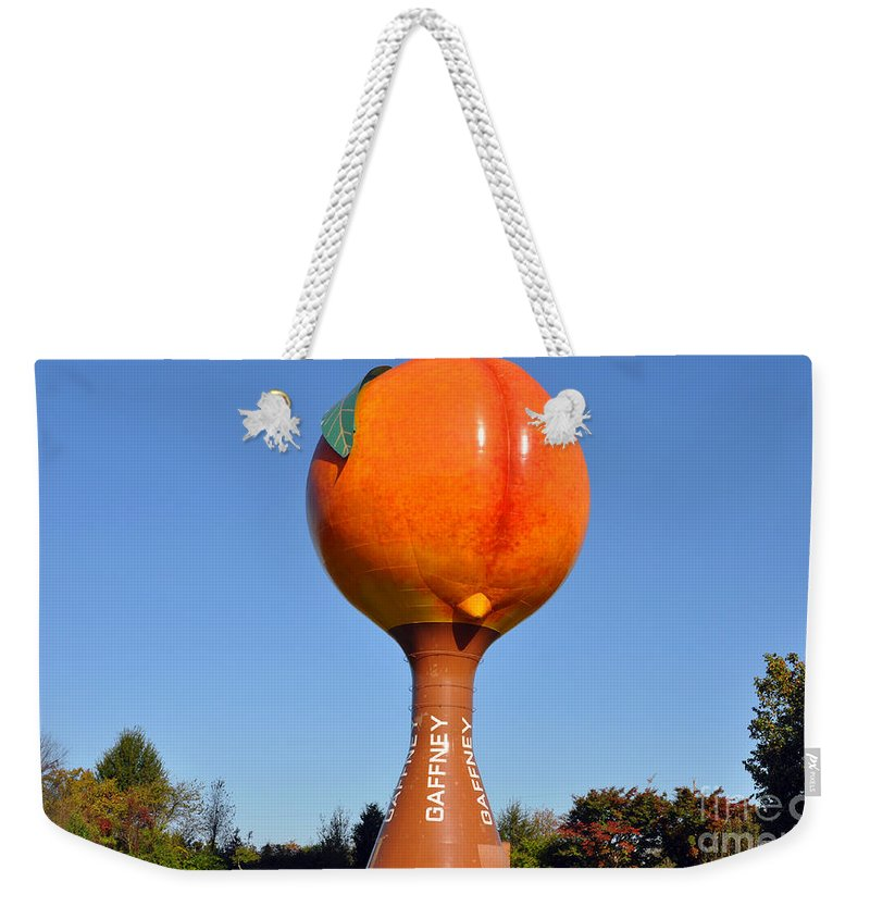 Watertower Weekender Tote Bag featuring the photograph Watery Peach by Lydia Holly