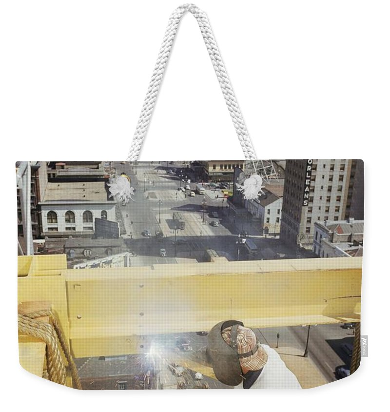 canal Street Weekender Tote Bag featuring the photograph Welder Working On The Construction by Justin Locke