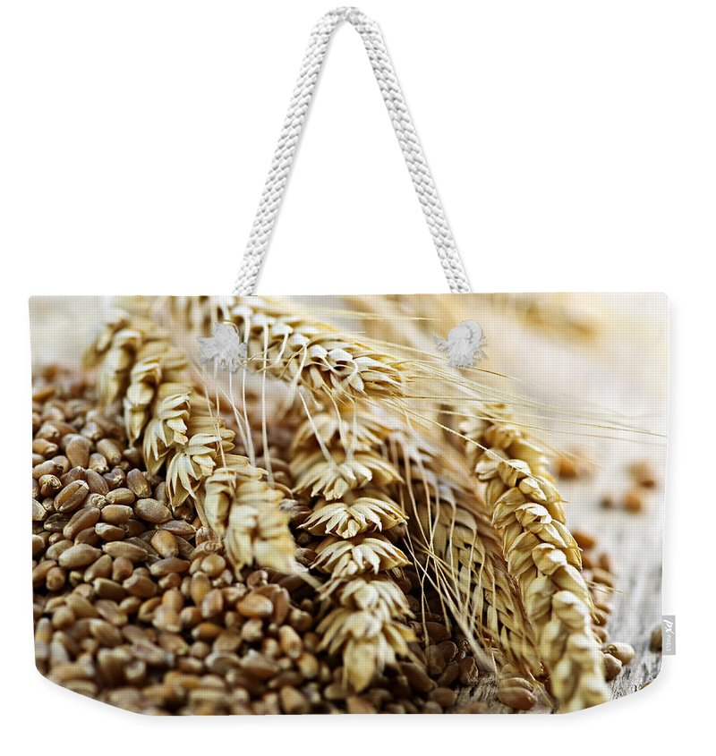 Wheat Weekender Tote Bag featuring the photograph Wheat Ears And Grain by Elena Elisseeva