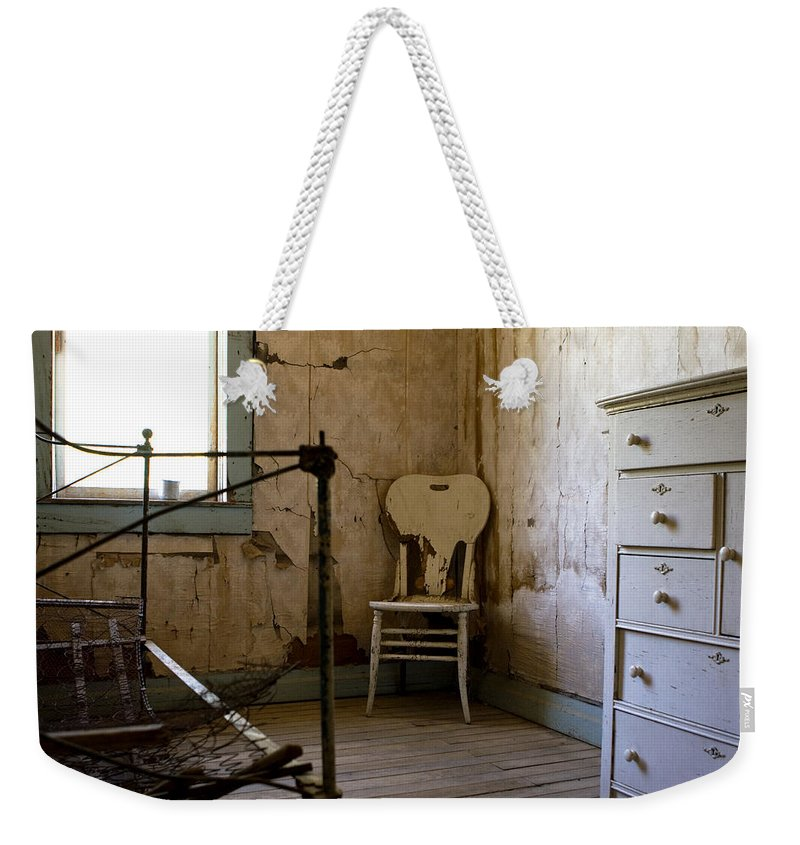 Old Bedroom Weekender Tote Bag featuring the photograph White Chair In The Bedroom by Lorraine Devon Wilke