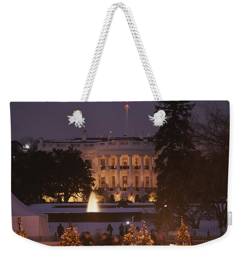 North America Weekender Tote Bag featuring the photograph White House, From Elipse At Christmas by Richard Nowitz