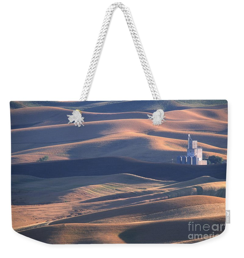 Palouse Weekender Tote Bag featuring the photograph Whitman County Granary At Sunset by Sandra Bronstein