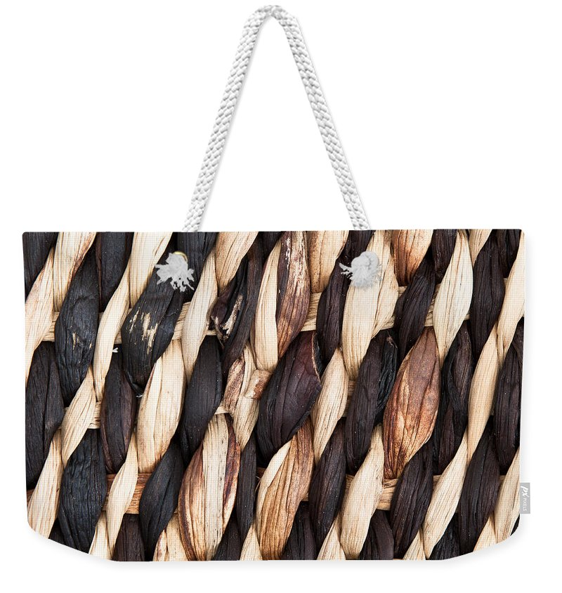 Abstract Weekender Tote Bag featuring the photograph Wicker Background by Tom Gowanlock