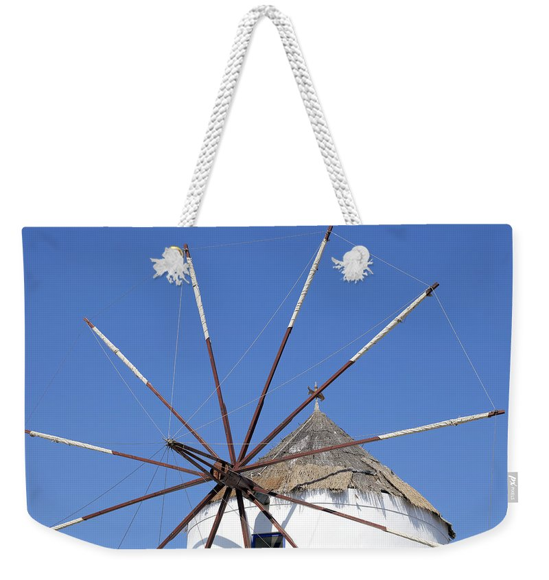 Windmill Weekender Tote Bag featuring the photograph Windmill In Santorini by Joana Kruse