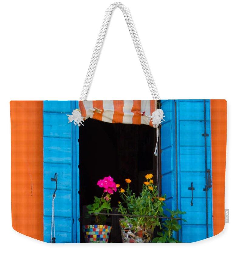 Orange Weekender Tote Bag featuring the photograph Window Plants by Jon Berghoff