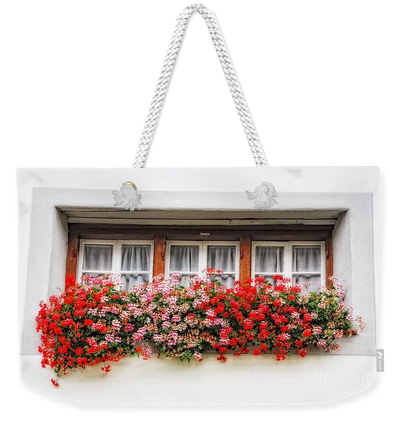 Window Weekender Tote Bag featuring the photograph Windows With Red Flowers by Mats Silvan