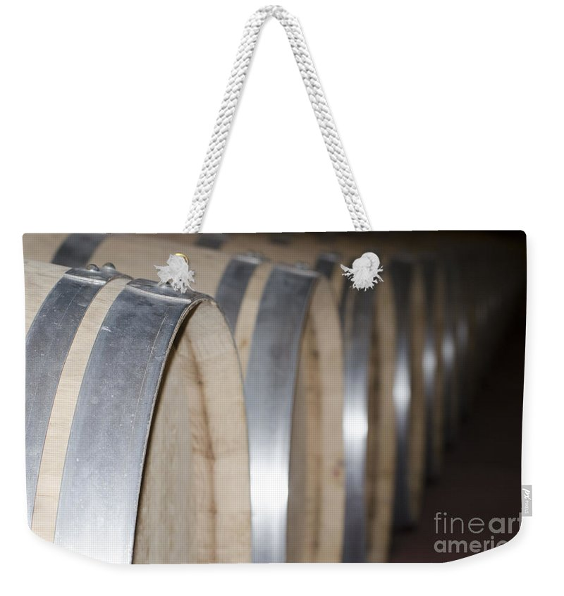 Wine Barrel Weekender Tote Bag featuring the photograph Wine Barrels by Mats Silvan