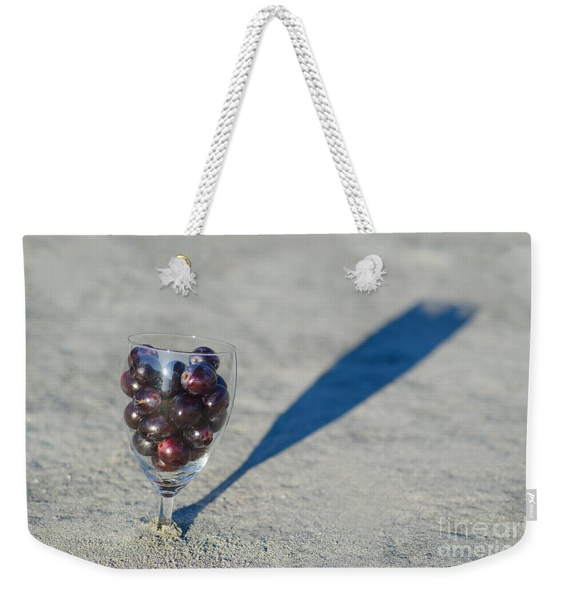 Wine Weekender Tote Bag featuring the photograph Wine Glass by Mats Silvan