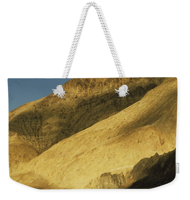 Color Image Weekender Tote Bag featuring the photograph Winter Sunlight On Desert Mountains by Gordon Wiltsie