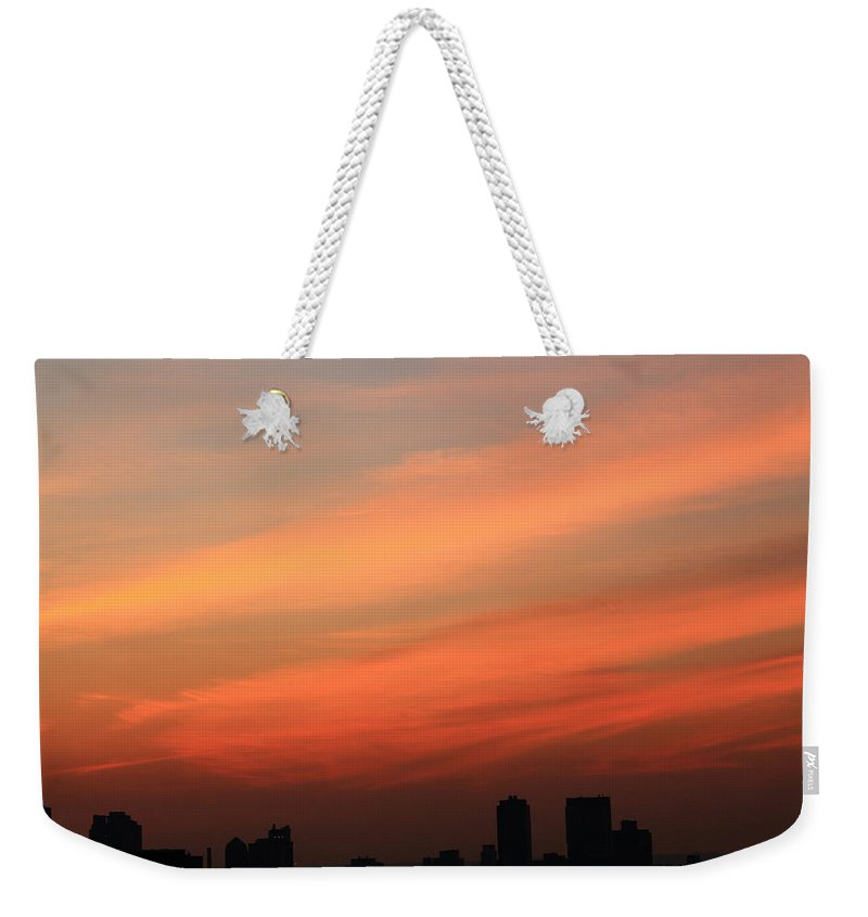 Sunset Weekender Tote Bag featuring the photograph Wispy Orange Sky by Catie Canetti