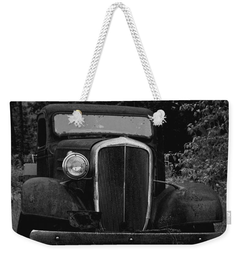 Old Cars Weekender Tote Bag featuring the photograph With One Eye Poked Out by Jeff Swan