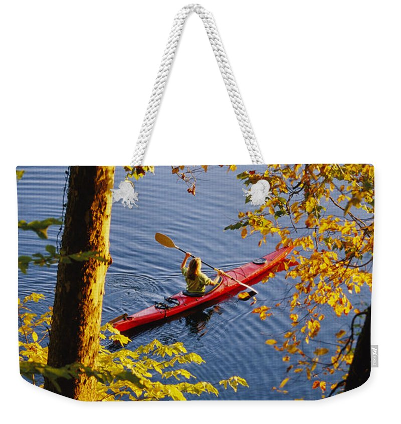 Boats Weekender Tote Bag featuring the photograph Woman Kayaking With Fall Foliage by Skip Brown
