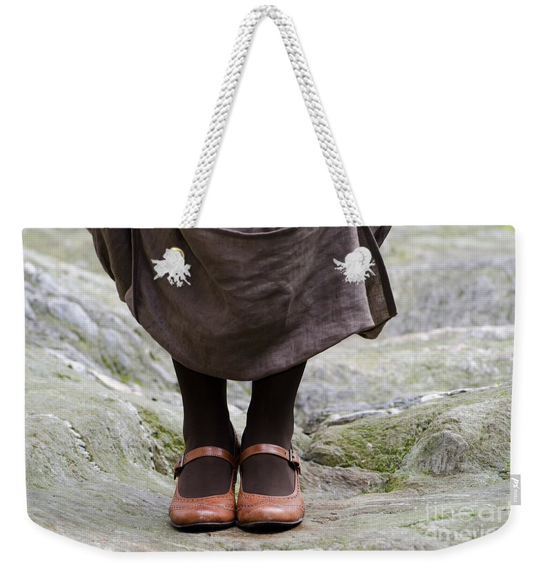 Woman Weekender Tote Bag featuring the photograph Woman Legs With Shoes by Mats Silvan