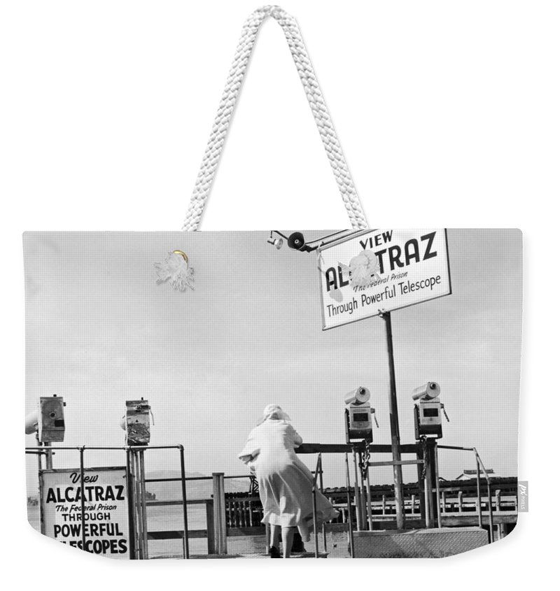 1950's Weekender Tote Bag featuring the photograph Woman Looking At Alcatraz by Underwood Archives