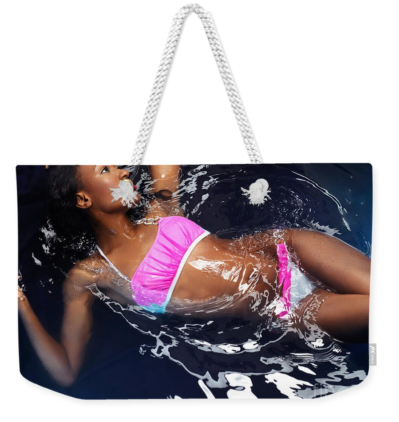Bikini Weekender Tote Bag featuring the photograph Woman Wearing Bikini Lying In Water by Oleksiy Maksymenko