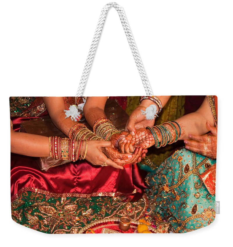 Hindu Weekender Tote Bag featuring the photograph Women With Decorated Hands Holding Hands In A Hindu Religious Ceremony by Ashish Agarwal