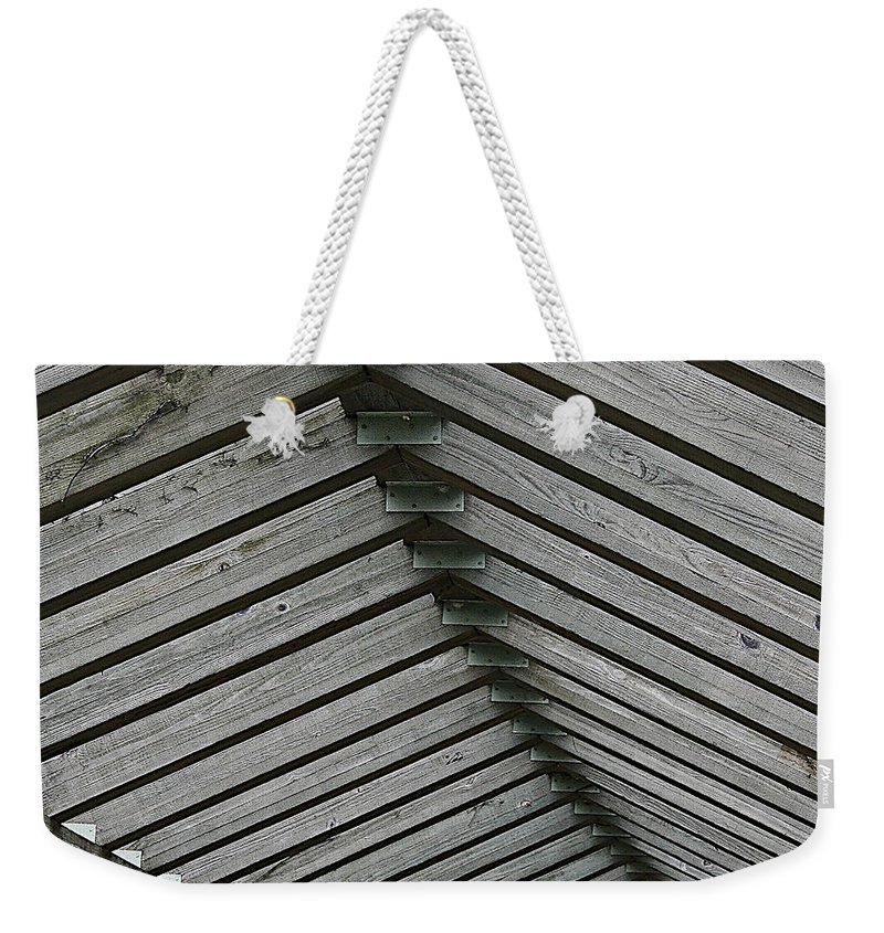 Wood Weekender Tote Bag featuring the photograph Wooden Ribs by Susan Herber