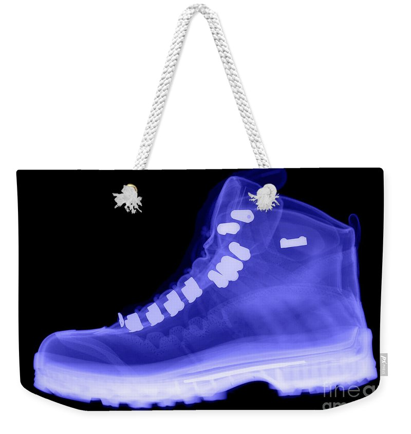 X-ray Weekender Tote Bag featuring the photograph X-ray Of A Hiking Boot by Ted Kinsman